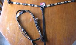 Never used black headstall and breast collar. Asking $100 obo for both.