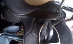16.5inches black english saddle in excellent condition comes with stirups and stirup irons and cover