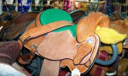 10k barrel saddle full quarter horse bars with a 15inch seat. Bran new! this is a very well made saddle and will fit most horses.