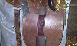 """Brand new! Never used as it didn't fit me or my horse. It is comfortable with a well padded seat, 15"""". Very soft leather. Comes with regular and back girths. Set up like an English saddle for the girth-no confusing configurations! You can use the strap"""