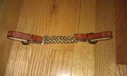 This is a Leather curb strap with double chain chinstrap, Brand new! Never used, I already have one for each of my horses so I don't need this one. I paid $10.00 plus tax for it. I'm selling it for $5.00 Please e-mail me.