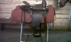 """This saddle is new, it is a roping/all around type with quarter horse bars. 14""""seat. Very nicely tooled. Any questions please call 403-651-7008 Thank you!"""