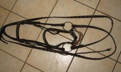 I have an english bridle(bit not included) and extra set of brand new reins, and 3 sets of brand new never used western bridles, reins & breast plates. for more info please email