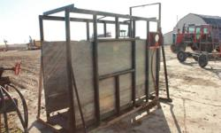 Weighs up to 3000lbs, includes chute with scale.  No Email, please call 306-842-5073.