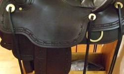 15.5 western sizing 16.5 Tucker sizing(135-185lbs) Gel-cush seat, Mahogany brown/black seat,Very comfortable for long rides and sharp looking, Full 1/4 horse bars, 3 way rigging, Real Brass conchos, Barb wire tooling, only used a couple of times. Tucker