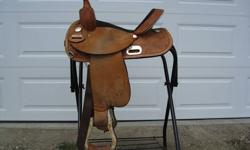 "The Proven Circle Y Barrel Saddle, 14"" black suede seat, Semi Quarter Horse Bars. Excellent condition. Serial # 2026-2407-0804"