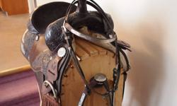 """Circle Y 14"""" equitation saddle, headstall, and breast band. Chocolate brown, very pretty, like new. $1100 c/w stand."""