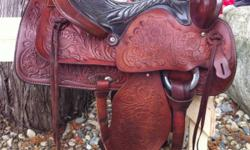 "Vintage 15"" Red Ranger saddle. Fully tooled, all leather. About 40 yrs old, in excellent condition with no marks or scratches. Very well looked after. Has 7.5"" gullet, solid horn & tree. Well made saddle. Has #918 on back. All original except fleece has"