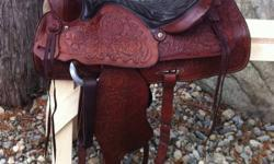 "Vintage 15"" Red Ranger saddle. Fully tooled, all leather. About 40 yrs old, in excellent condition with no marks or scratches. Very well looked after. Has 7"" gullet, solid horn & tree. Well made saddle. Has #918 on back. All original except fleece has"