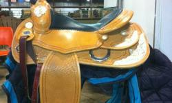 "Excellent Condition  Model - Continental Saddlery - The Lone Reiner Equi-Flex tree Full QH Bars 6 3/4"" Gullet width 16.5"" Seat Price - $1,800.00   Excellent Condition (Saddle with all the Silver) Model - Continental Saddlery - Silver Show Reiner Equi-Flex"