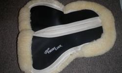 Ultra ThinLine Performance Sheepskin Comfort Half Pad made of 100%  merino sheepskin. Also selling shimmys which can be used to modify saddle fit. Sells for $249.00 + 35.00 for shimmies. Only asking $100.00 for both. Call 705495-8989
