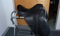 "18"" Black Dressage Saddle with irons and girth. Asking $300"