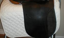 "This dressage saddle is a beautiful black 18"", 32 cm tree width, Stubben Tristan Special Dressage Saddle. It is constructed on a ½ panel, with no knee roll allowing for as little as possible to come between the horse and rider, giving closer contact than"