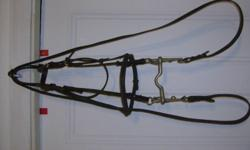 Brown english bridle, with english curb bit and reins. Pretty braided look nose band. $30