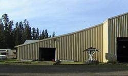 Equestrian Center for sale in Prince George, BC.  Horse training/boarding delux large modern 40x140 barn includes 20 box stalls (metal lined, rubber mats), infloor cleanout system- heated, waterers in each stall. 65x140 indoor metal arena attached, inside