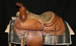 """Canadian made in Alberta, F-Eamor saddle. 15"""" seat, some discolour but doesn't impact the quality of the saddle. Dennielle at 519-777-6763."""