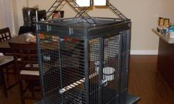 """Selling our large parrot cage. It is in excellent condition and would make any parrot happy! It's cage dimensions are 24""""W x 22""""D x 32""""H so it is fairly large. The entire cage stands 63"""" tall with the stand and playstand. There is also an additional toy"""