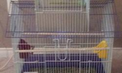 I have 2 cages and 3 birds for sale in excellent condition. The purple cage is extra nice Two birds are zebra finches and the other one is a very nice masked finch. Complete with all accessories and food. Great little pets. Sell altogether or separate.