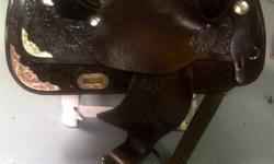 Hey im selling a showman handmade leather saddle. 16 seat, and in great condition. Also mathching bridle comes with. Just purchased it second hand, but it does not fit my paint. For some reason my camera is making everything look gold, but it is actually