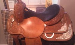 """PRICE REDUCED FOR QUICK SALE!! Beautiful Circle Y youth show saddle, 14.5"""" seat with semi-QH bars (fits 80 % of horses). AQHA circuit quality, was shown in at Congress. Comes with saddle bag, folding saddle stand and girth. Serial number is: 291714570396"""
