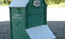 """Alberta Wheat Pool Bird House. 41"""" tall  and a 2'x2' base. Can be personalized with your home town name. Excellent Christmas gift. Only two left. $150.00"""