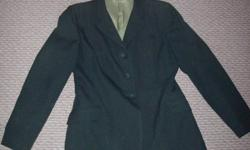 Grandprix Show Coat, hunter green with pin stripes Size 16Tall. I bought it used and it no longer fits. Measurements: Shoulder seam to shoulder seam 16 ½?, shoulder seam to cuff 23?, length is 26?. It has a light green silk on the inside, which has a few