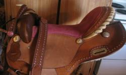 """BEAUTIFUL 17"""" FULL QUARTER BAR WESTERN SADDLE WITH A WELL PADDED PINK SEAT. THIS SADDLE COMES WITH MATCHING HEADSTALL AND BREAST COLLAR. VERY NICE WELL MADE SADDLE, ALTHOUGH I CAN'T FIND A MAKERS MARK. TAKING OFFERS!!!"""