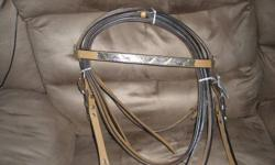 Put a little bling under the tree for your horse crazy loved one!   2 brand new headstall, rein & breast collar sets. Retail would be over $150 per set. Both headstalls ALONE retail for  $90 +  US (one has the price tag on it).   $100 FIRM per set   Set 1
