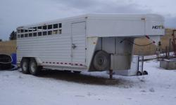 We purchased this trailer new in 2006. It has not been used commercially. It has been used to transport our riding horses and a few sheep. It is is excellent shape. The floor is 20 feet. The entire length is 28 feet. It has a nice tack area with divider.