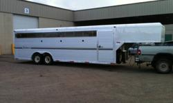 24' JAIMCO Stock Trailer in LIKE NEW condition. Built with unique tongue-and-groove double-thick aluminum interlocking plank walls and seamless, single-piece aluminum roof for durability & waterproof performance. Lexan windows that slide in & out for