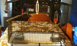 """LOVELY     BLACK BIRD CAGE    WITH HOOK TO HANG       .............         FEATURES     SWING     PERCHES     FEEDERS     WATER FEEDER         SIZE     21  WIDE     21   HIGH     11   DEEP       THIS   WOULD MAKE   A   """"PERFECT HOME""""   FOR A CANARY,"""