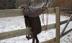 """Super comfy slick seat.  These saddles are only made with a 15"""" seat.  Built light for long hours and ease of saddling.  Has adjustable rigging and Blevins buckle stirrups.  Comes with original plastic stirrups as well as upgraded leather stirrups.  Can"""