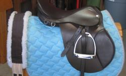 """-Barely used dark brown english saddle 17"""" seat -Brand new stirrup irons -brand new Girth w/ tags still on paid $40.00 -Good condition light blue saddle pad w/ silver stitching around border -Also includes matching light blue rope halter w/ leadrope"""