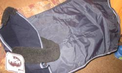 hi i have an couple bankets that i am willing to trade for samller size blankets they are new and stll have price tags on the very good quality 2 turnout blankets purple and blue size 80 water proof but not insulated 3 winter bllanket are insulated and
