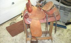 "New 15.5"" roping saddle. Unfininshed leather with tooling. Comes with back cinch, front cinch and saddle pad could also be included. Been store inside, has a bit of dust on it but other than that it is in new condition. There are pictures of it and more"