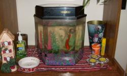 hey, i have an older fish tank with goldfish and snale in it, i need to get rid of it as i no longer have time for it nor does my family, please email me back if interested, 25.00 or best offer (will not take any less than 15.00)