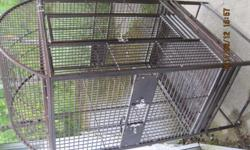 """have a large parrot cage for sale. Brown finish , EXCELLENT condition (no rust or paint missing etc). 3 feeder doors that swing open so you can change food and water from outside of cage.  Cage has """"seed guards"""" ,measurements are...22"""" depth, 24"""" width"""