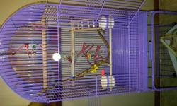 Beautiful unique spacious purple coated bird cage on roller with lower shelf. All items in photo included, water & food bowl, toys, ledges. Purple coat is safe for pets and not toxic. Also included 90% full Prestige Premium & Fruit Blend food and treats.