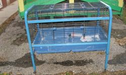 I have various rabbit cages. Different sizes and styles. Can be bought as a group. CHRISTMAS SPECIALS --THE BLUE ONE ON WHEELS-ASSORTED PLASTIC BOTTOM ONES---ALL COMES WITH FOOD BOWLS AND WATER DISPENSERS. ONE MUST TAKE ALL EVERYTHING-$100.00 FOR