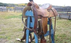Older saddle in excellent shape; double rigging,cinches and breast collar- I have too many saddles but interested in a kid's saddle trade