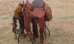 "15 1/2"" Custom built association saddle. Padded Seat, Cheyenne Roll, Drop Plate Rigging. Basketweave tooling with a barbed wire border. Comes with matching basketweave breast collar and saddle bags. Very comfortable, good fitting saddle.  Asking $1200"