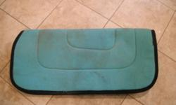 Offering for sale a reversible fleece saddle pad. Great as an underpad, or to add some color during games. Turquoise on one side, can be reversed to lilac on the other.  $25 obo.