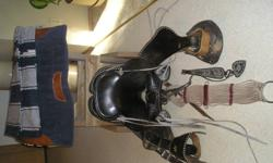 "black 15"" studded saddle with leather tooling (checker board design) covered stirrup comes with cinch. 20+ years old in very good shape (better made than newer ones) $300.   -saddle stand wooden $25.  -blue blanket and pad in very good shape $50."