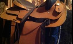 """15.5"""" light colored saddle for sale. Comes with bridle 2 halters and a lead rope. The saddle doesn't fit my horse. Asking 450obo This ad was posted with the Kijiji Classifieds app."""