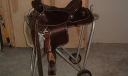 FOUR SADDLES 2 CUSTOM TRAIL SADDLES MADE BY KEY LOG SADDLERY.$550.00 each size 16 in.. ONE CROSBY SOVERIGN CLOSE CONTACT $350.00 size 17in. WINTEC ALL PURPOSE $75.00 17in ALSO AN ASSORTMENT OF PADS AND BLANKETS ALSO SOME BRIDLES.