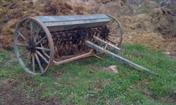 ANTIQUE SEEDER IN WORKING CONDITION FOR SALE WAS USED 2 YEARS AGO, JUST PULLED IT OUT OF THE BARN, NEED ROOM FOR THE HAY   $1000 OR BEST OFFER