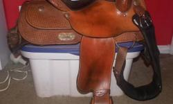 """Would like to sell my Silver Supreme Saddle ASAP. It's FQHB, 15"""" seat, basketweave with silver accents. It's a really great saddle and I would love to keep it, but have no need for it anymore. Would like to get $900 for it but I am open to any reasonable"""