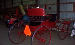 Single horse wagon for sale. Seats 2 adults, new upholstery & paint, solid rubber tires.  We have no method of delivery, but it should fit in a regular half ton.  $600.00 firm.