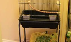 Standing bird cage for sale COMPLETE with all the trimmings!! Ideal for your new budgie, canary, cockatiel, lovebird or most other small birds. (Can hold multiple birds depending on the size) Cage Description: - Size: 56cm(height) X 44cm (width) X 30cm