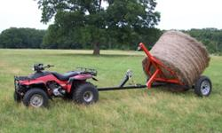 Single Bale Mover...pull behind your ATV, pickup, or whatever you have.  Quick and easy to use.